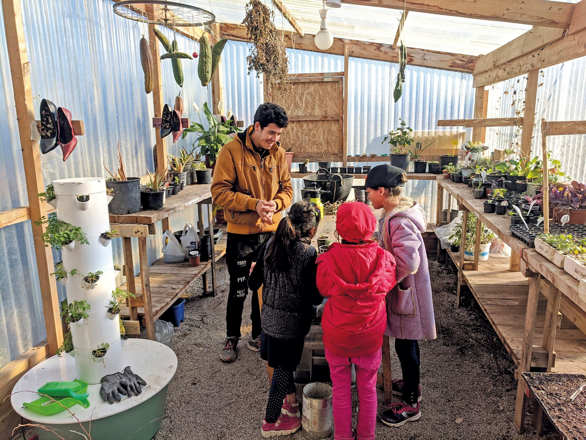 EcoHub©RachaelLeClear.jpg – Friday afternoons are busy with herb cutting workshops, where visitors come to learn about propagation and collect free herb starts